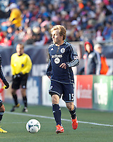 Sporting Kansas City defender Seth Sinovic (15) brings the ball forward.   In a Major League Soccer (MLS) match, Sporting Kansas City (blue) tied the New England Revolution (white), 0-0, at Gillette Stadium on March 23, 2013.