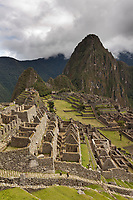 Huayanapichu (young mountain) in the distance at Machu Picchu, the ancient &quot;lost city of the Incas&quot;, 1400 CA, 2400 meters. Discovered by Hiram Bingham in 1911. One of Peru's top tourist destinations.