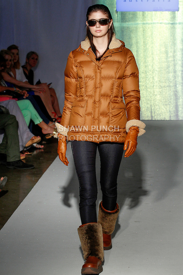 Model walks runway in an outfit from the UGG collection, during the SNOW Fashion NYC - Apres ski fashion show, June 11, 2013.