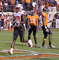 Nov 13, 2010; Charlottesville, VA, USA;  Maryland Terrapins wide receiver Torrey Smith (82) runs past Virginia Cavaliers cornerback Chase Minnifield (13) and Virginia Cavaliers safety Rodney McLeod (4) after scoring a touchdown during the 2nd half of the game at Scott Stadium. Maryland won 42-23. Mandatory Credit: Andrew Shurtleff
