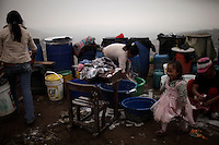 An old student's desk is used to hold washing clothes at  the human settlement of Defensores de la Familia in the outskirts of the Peruvian capital, Wednesday, March 13, 2011.(Photo Dado Galdieri)