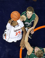 CHARLOTTESVILLE, VA- NOVEMBER 26:  Akil Mitchell #25 of the Virginia Cavaliers shoots over Alec Brown #21 of the Green Bay Phoenix and Brennan Cougill #44 of the Green Bay Phoenix during the game on November 26, 2011 at the John Paul Jones Arena in Charlottesville, Virginia. Virginia defeated Green Bay 68-42. (Photo by Andrew Shurtleff/Getty Images) *** Local Caption *** Brennan Cougill;Akil Mitchell;Alec Brown
