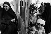 """Baghdad, Iraq, June 7, 2003.Women and children waiting for medecine and vitamine distribution at an """"ECHO"""" sponsored clinic in Hay Tareq, the most miserable slums around Baghdad.."""