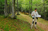 A hiker consulting a map in a forest