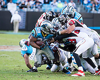 The Carolina Panthers defeated the Atlanta Falcons 34-10 in an inter-division rivalry played in Charlotte, NC at Bank of America Stadium.  Carolina Panthers running back Jonathan Stewart (28) is has his face mask grabbed by Atlanta Falcons outside linebacker Paul Worrilow (55)