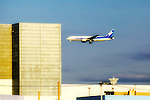 An All Nippon Airlines plane flies into Haneda Airport in Tokyo, Japan.