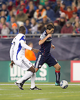 New England Revolution forward Marko Perovic (29) brings the ball forward as Kansas City Wizards defender Shavar Thomas (6) closes. The New England Revolution defeated Kansas City Wizards, 1-0, at Gillette Stadium on October 16, 2010.