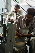 Workers making polishing gem stones for fine jewelry at  a workshop in Sanganer in Jaipur, Rajasthan, India.