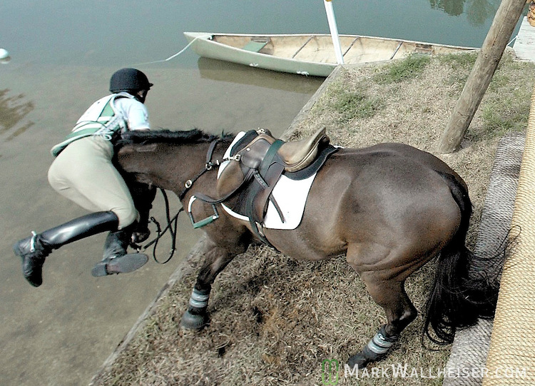 """Adrienne Iorio-Borden seperates from """"Show of Heart landing in the water after going over Apalachee Bay jump.  The horse balked at the four foot drop into the water after coming over a four foot high jump and Iorio-Borden went over the horses head.  They were in the CIC-W Three Star Division."""