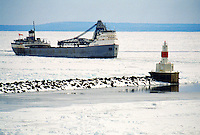 THE FREIGHTER SAGINAW IS LEAD THROUGH LAKE SUPERIOR PACK ICE INTO MARQUETTE'S UPPER HARBOR BY A CANADIAN ICE BREAKER.