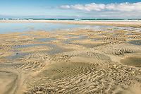 Sand patterns on empty beach at Paturau on west coast of South Island, Nelson Region, New Zealand
