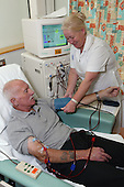Support Nurse on Dialysis Unit checking renal outpatients blood pressure. MR