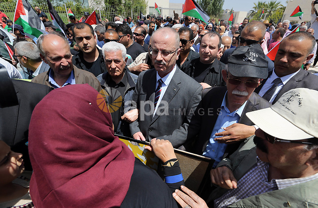 "Palestinian Prime Minister Rami Hamdallah takes part in a rally to mark the 69th anniversary of the ""Nakba"" or ""catastrophe"" in Arabic in reference to the establishment in 1948 of the state of Israel, in the West Bank city of Ramallah on May 15, 2017. Nakba"" means in Arabic ""catastrophe"" in reference to the birth of the state of Israel 69-years-ago in British-mandate Palestine, which led to the displacement of hundreds of thousands of Palestinians who either fled or were driven out of their homes during the 1948 war over Israel's creation. The key symbolises the homes left by Palestinians in 1948. Photo by Prime Minister Office"