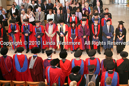 All stand as the dignitaries arrive for the graduation ceremony, University of Surrey.