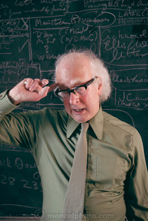 Physics: British theoretical physicist Professor Peter Higgs in his University office in Edinburgh, Scotland (b. 1929). In 1964, Higgs predicted the existence of a new type of fundamental particle, commonly called the Higgs boson. This particle is required by many of the current Grand Unified Theories (or GUTs), which hope to explain three of the fundamental forces (electromagnetism, the weak & the strong nuclear forces) in a single unified theory. The Higgs boson is yet to be detected experimentally, but it is one of the main challenges of high-energy particle accelerators now being built. Higgs is professor of theoretical physics at Edinburgh University. MODEL RELEASED [1988]