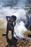 The 21st annual Lincoln County Cowboy Symposium was held in October 2010 at the Ruidoso Downs Racetrack in Ruidoso, New Mexico. Cowboy cooking is a smioky business.