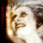 A blurred image of a beautiful woman gazing upward
