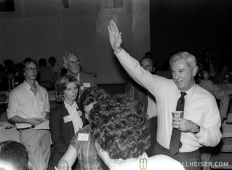 Past Florida Governor and presidential candidate Reubin Askew talks and shakes hands with supporters at a fundraising event at the Leon County Fairgrounds in Tallahassee, Florida September 29, 1983.