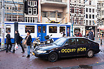 Saab car with graffiti parked at the Occupy Amsterdam demonstration outside the Amsterdam Stock Exchange at Beursplein, Amsterdam, the Netherlands. This is one of many 'occupy' protests following the Occupy Wall Street protests in New York, against economic inequality. October 19th 2011. Copyright 2011 Dave Walsh, davewalshphoto.com