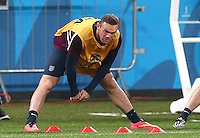 Wayne Rooney of England stretches during training ahead of tomorrow's Group D match vs Uruguay