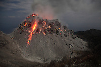 Glowing Rerombola lava dome of Paluweh Volcano during eruption in 2012, Flores, Indonesia.