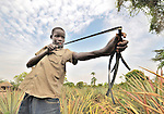 David Suba, 13, hunts small game with a slingshot in the village of Pisak, in Southern Sudan.
