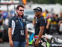 Aug 19, 2016; Brainerd, MN, USA; Papa Johns pizza founder John Schnatter (left) talks with NHRA top fuel driver Antron Brown during qualifying for the Lucas Oil Nationals at Brainerd International Raceway. Mandatory Credit: Mark J. Rebilas-USA TODAY Sports