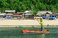 A seaweed farmer in front of the village, Kutuh, Bali, Indonesia.