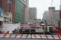 construction workers in New York City working on a street and building