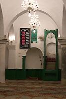 Tripoli, Libya. An-Nagah Mosque, Electronic Digital Clock showing Prayer Times, Qibla, and Minbar (Pulpit).  Tripoli's first mosque, rebuilt 17th Century.