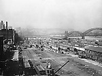 Pittsburgh PA - View of the Pennsylvania Railroad yards in the Strip District section of Pittsburgh - 1925. View of the strip prior to the construction of the produce yards. 16th Street bridge and Allegheny River in the background.
