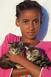 Girl with kittens, Arniston, South Africa