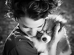 Owner Jacquelyn Jacobs embraces her Pomeranian Princess.