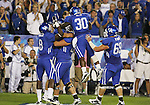 The University of Kentucky celebrates a touchdown against Auburn at Commonwealth Stadium on Saturday, Oct. 9, 2010. Photo by Scott Hannigan | Staff