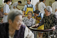 Japan has too many elderly and not enough young people to staff all the nursing homes and care units in hospitals, so they have a program that brings in thousands of Philipino and Indonesian workers just for that purpose.  The two women in these photographs helping the elderly at the outpatient care unit are:.SITUMORANG (Last Name), Elvina (Indonesian) : .GOLLAYAN (Last Name), Maria Donnabel Pascua (Filipino) ..This is the hospital that has the robotic legs and the immigrant workers are being brought in for the same reason the robotics people are working on solutions for lonely elderly.  All of these robotics folks developing robots for elderly talk about studies showing that more and more elderly are isolated and have no one to relate to... In 2009 it was 19 percent of the elderly population of Japan.  They have a word for it:  &quot;Kodokushi&quot; or &quot;lonely death.&quot;.