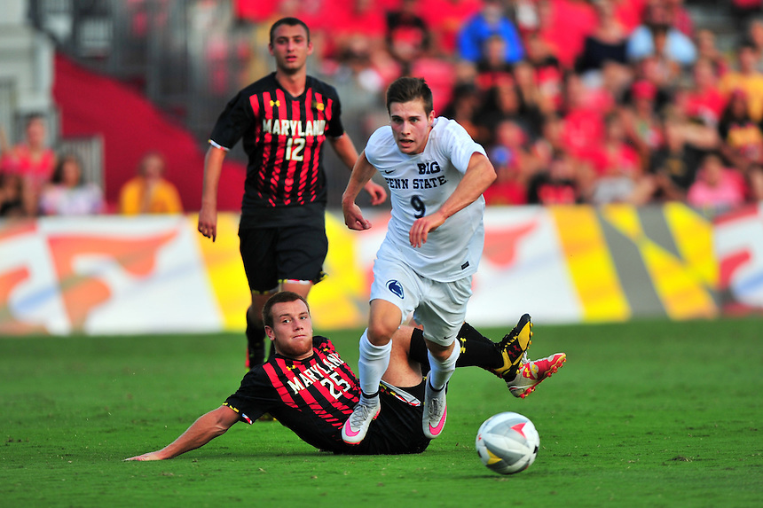 Austin Maloney of Penn State slips passed a defender. Maryland defeated Penn State in over time 3-2 during an NCAA D-1 soccer match at Ludwig Field in College Park, MD on Sunday, September 18, 2016.  Alan P. Santos/DC Sports Box