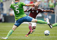Colorado Rapids forward Sanna Nyassi takes a shot on goal past Seattle Sounders FC defender Tyson Wahl during play at CenturyLink Field in Seattle Saturday July 16, 2011. The Sounders won the game 4-3.