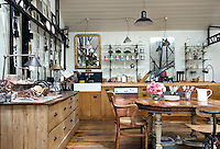 The kitchen/diner in this country house is a treasure trove of antique furniture and mismatched objects