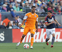 Houston Dynamo forward Giles Barnes (23) passes the ball.  In a Major League Soccer (MLS) match, the New England Revolution (blue/white) defeated Houston Dynamo (orange), 2-0, at Gillette Stadium on April 12, 2014.