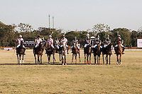 Both the teams line up before they battle for the Argyle Pink Diamond Cup, organised as part of the 2013 Oz Fest in the Rajasthan Polo Club grounds in Jaipur, Rajasthan, India on 10th January 2013. Photo by Suzanne Lee