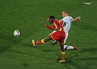 Jay DeMerit of USA is unable to stop the shot of Asamoah Gyan of Ghana. Ghana defeated the USA 2-1 in overtime in the 2010 FIFA World Cup at Royal Bafokeng Stadium in Rustenburg, South Africa on June 26, 2010.