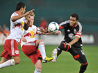 Raphael Augusto (25) of D.C. United goes against Dax McCarty of The New York Red Bulls (11) The New York Red Bulls defeated D.C. United  2-0, at RFK Stadium, Saturday April 13, 2013.