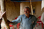 A Kurdish farmer photographed at his family home near Rawandiz, Iraq. ..Stability and security prevail in postwar Iraqi Kurdistan as Iraqi tourists, many of them from Baghdad, flock to the northern cities and their amusement parks and national parks to escape violence and sectarian strife in the central and southern regions of the country.