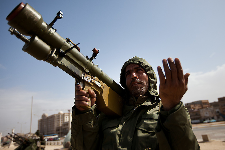 A volunteer soldier holding a surface to air missile launcher prays as he scans the sky for planes loyal to Qadaffi in Benghazi on March 2, 2011.
