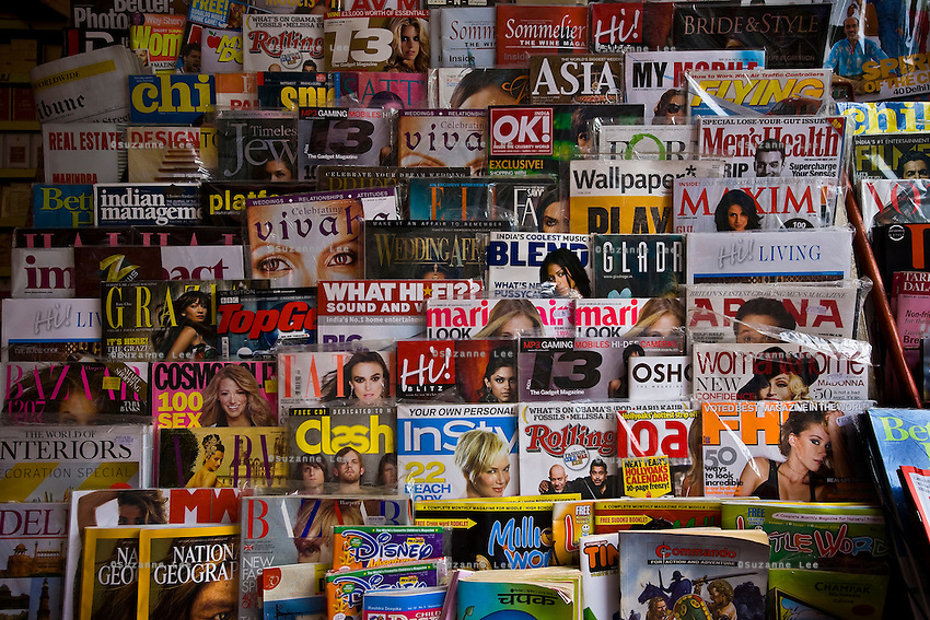 Indian and Indian versions of international magazines are displayed for sale at a newsstand in Defence Colony market in New Delhi on 18 September 2008. Photo : Suzanne Lee for The National.