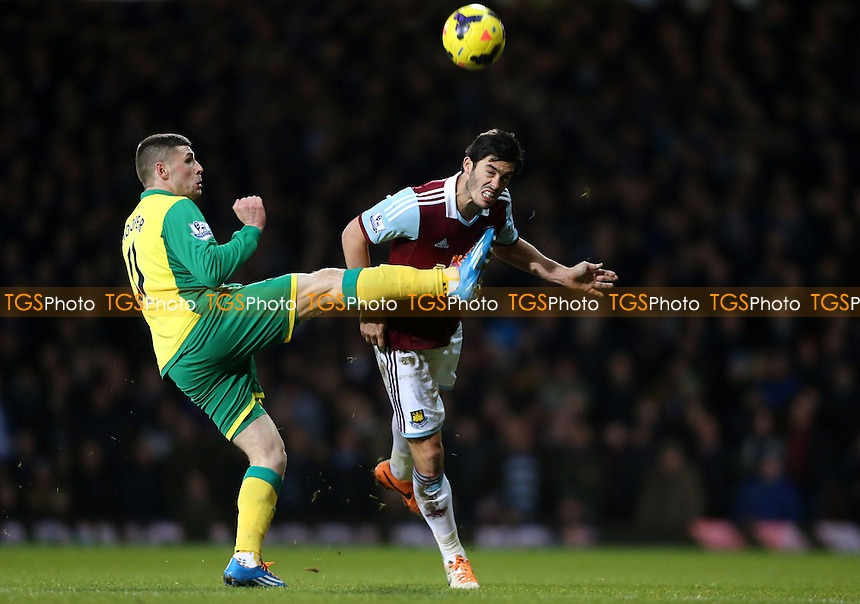 James Tomkins of West Ham and Gary Hooper of Norwich - West Ham United vs Norwich City, Barclays Premier League at Upton Park, West Ham - 11/02/14 - MANDATORY CREDIT: Rob Newell/TGSPHOTO - Self billing applies where appropriate - 0845 094 6026 - contact@tgsphoto.co.uk - NO UNPAID USE