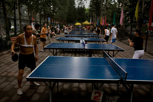 Beijingers play table tennis at a ping pong club in Beijing, China on Wednesday, August 13, 2008.  Kevin German