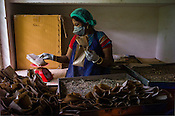 A local worker packs the herbs at the Pharmacy of the National Research Institute of Panchakarma in Cheruthuruthy in Thissur district of Kerala, India.