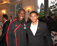Andy Najar of DC United with Clarence Seedorf of AC Milan at a reception for AC Milan at DAR Constitution Hall in Washington DC on May 24 2010.
