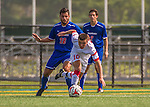 5 September 2014: University of Massachusetts River Hawks Midfielder Augusto Trento (28), a Junior from Leominster, MA, battles St. Francis College Terrier Harry Odell, a Junior from Manchester, England, at Virtue Field in Burlington, Vermont. The River Hawks defeated the Terriers 3-1, on their way to finishing the Morgan Stanley Smith Barney Windjammer Classic Men's Soccer Tournament with a 2-0 record, and being crowned as tournament champions on goal differential. Mandatory Credit: Ed Wolfstein Photo *** RAW (NEF) Image File Available ***